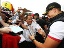 Michael Schumacher signs autographs on the 20th anniversary of his first grand prix start