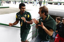 Karun Chandhok chats to Jarno Trulli ahead of first practice