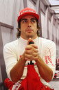 Fernando Alonso waits patiently in the pits