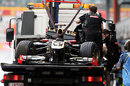 Bruno Senna's crippled Renault is towed away