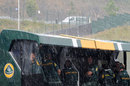 Rain lashes down on the Lotus pit wall