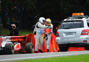 Lewis Hamilton is helped away after crashing out