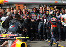 Sebastian Vettel celebrates victory with his Red Bull team