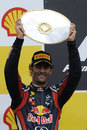 Mark Webber celebrates his second place finish
