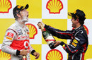 Sebastian Vettel sprays Jenson Button with champagne