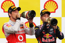 Sebastian Vettel and Jenson Button enjoy a drink