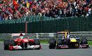 Sebastian Vettel passes Fernando Alonso