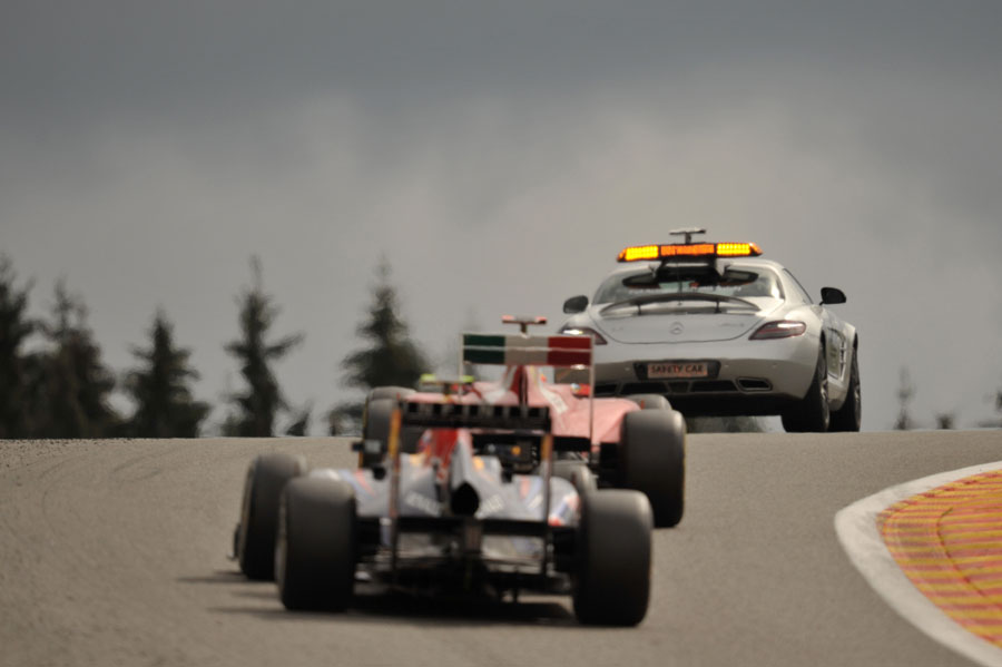 The leaders follow the safety car
