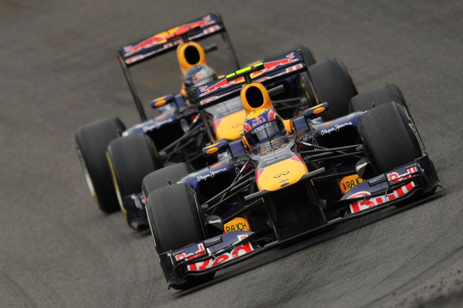 Sebastian Vettel shadows Mark Webber