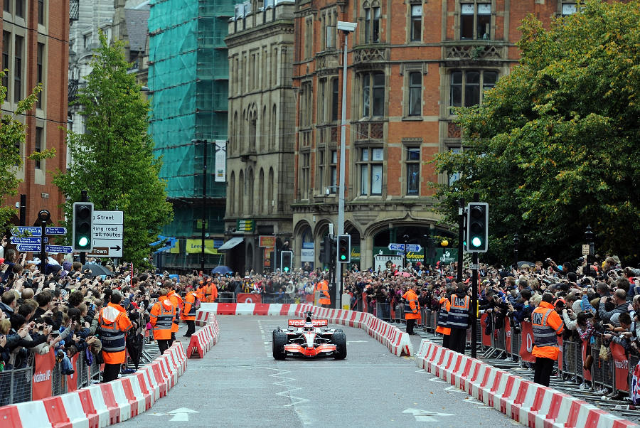 Jenson Button demonstrates a McLaren on the streets of Manchester