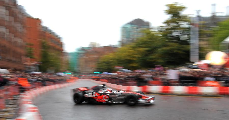 Jenson Button at speed during a demonstration run in Manchester