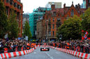 Jenson Button takes a McLaren on a demonstration run in Manchester