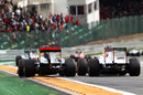 Jenson Button goes wheel-to-wheel with Sergio Perez