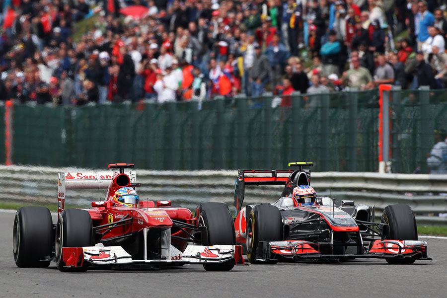 Jenson Button eases level with Fernando Alonso along the Kemmel straight