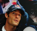 Mark Webber talks to the press