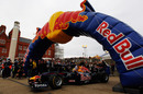 Mark Webber drives his Red Bull F1 car through the city streets of Cardiff