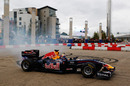 Mark Webber wows the crowd by performing donuts through the city streets of Cardiff at the Red Bull Speed Jam event