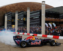Mark Webber performs donuts through the city streets of Cardiff at the Red Bull Speed Jam event