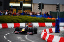 Mark Webber drives his Red Bull through the city streets of Cardiff