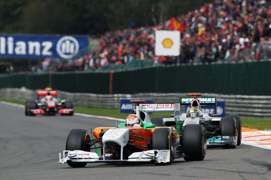 Adrian Sutil leads Michael Schumacher and Jenson Button