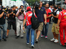 Felipe Massa catches photographers' attention in the paddock