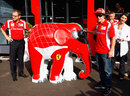 Fernando Alonso signs a model elephant painted in Ferrari colours