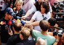 Sebastian Vettel faces a bank of TV reporters