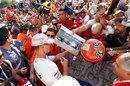 Michael Schumacher signs autographs for the fans