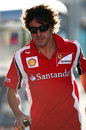 Fernando Alonso jogs through the paddock