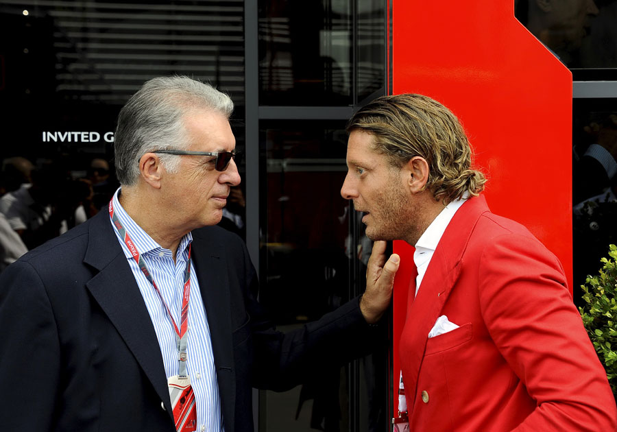 Piero Ferrari and Lapo Elkann talk in the paddock