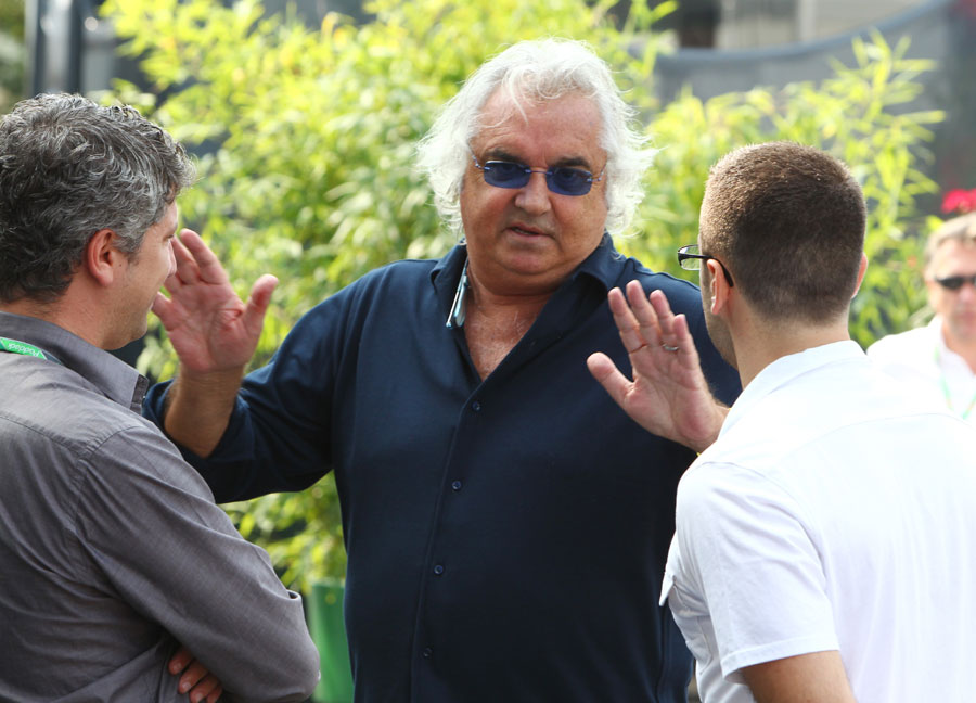Flavio Briatore holds court in the paddock