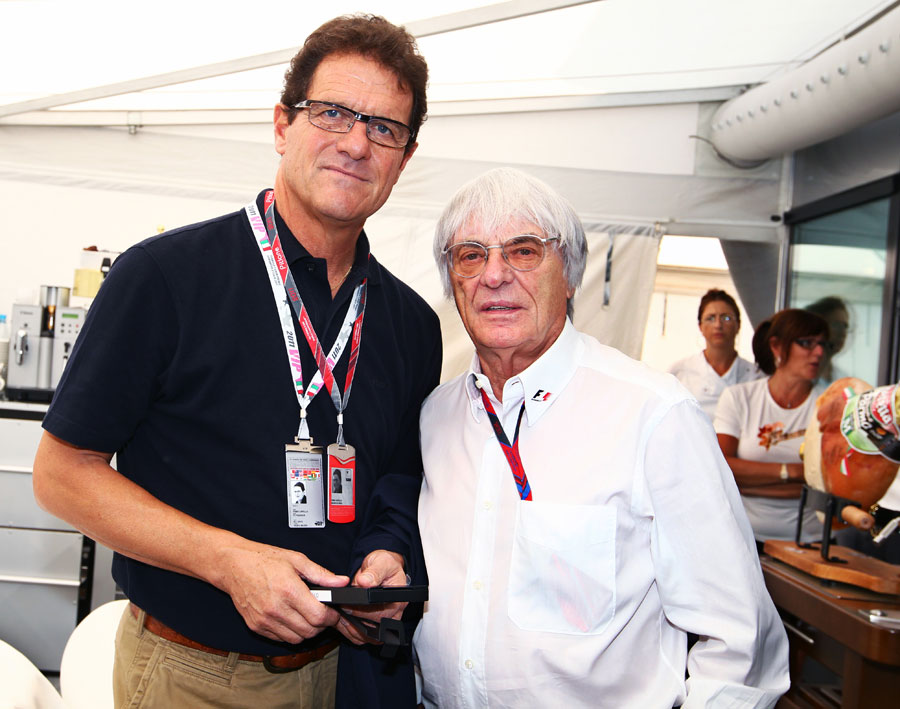 England football manager Fabio Capello with Bernie Ecclestone in the paddock
