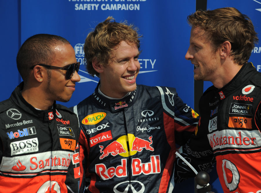 Sebastian Vettel enjoys his pole position with Lewis Hamilton and Jenson Button