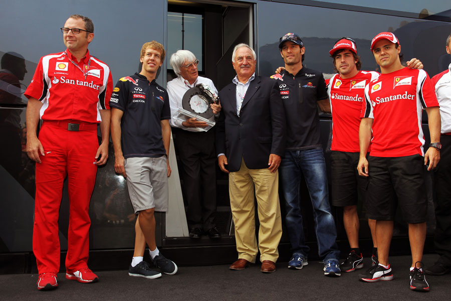 Bernie Ecclestone is presented with a Brembo brake on Sunday morning