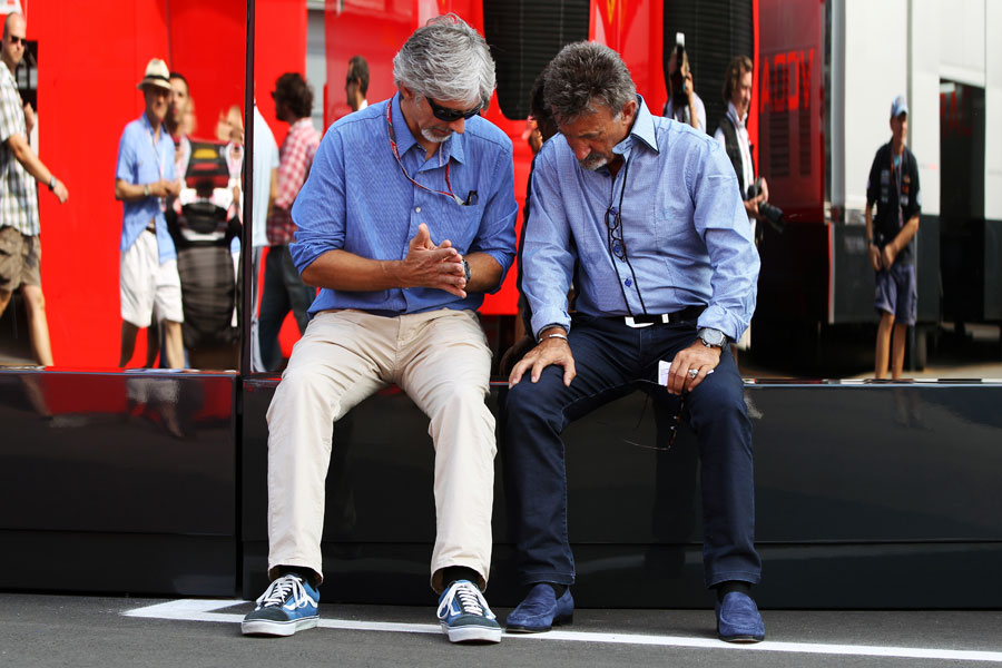 Damon Hill and Eddie Jordan deep in discussion in the paddock
