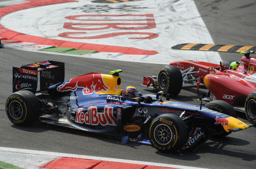 Mark Webber loses his front wing after tapping Felipe Massa in to a spin