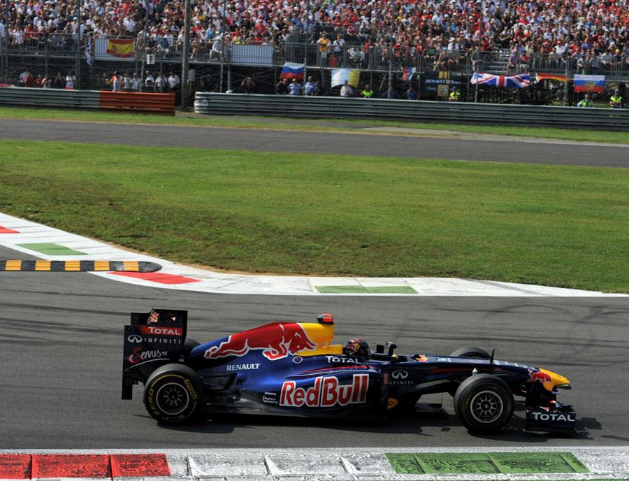 Sebastian Vettel eases towards victory