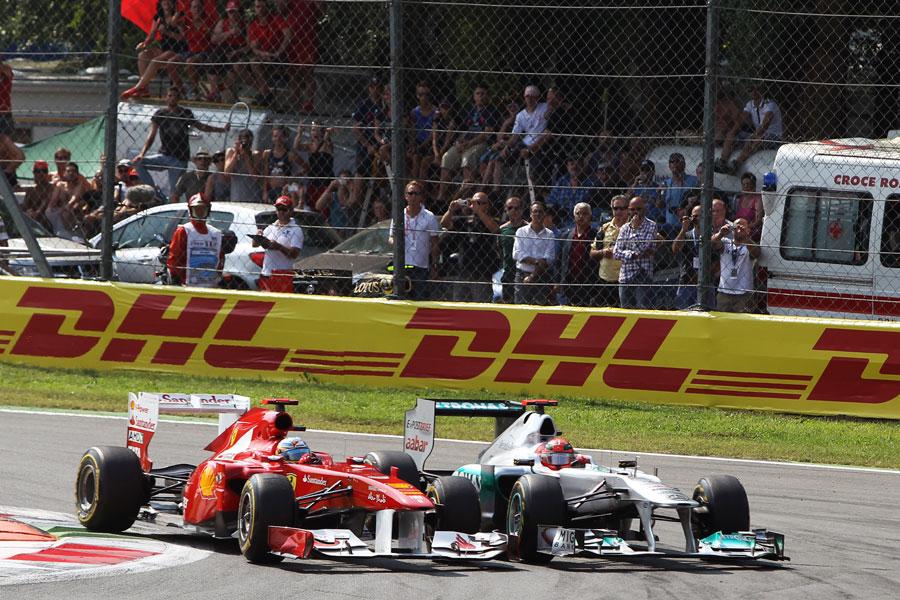 Michael Schumacher battles with Fernando Alonso