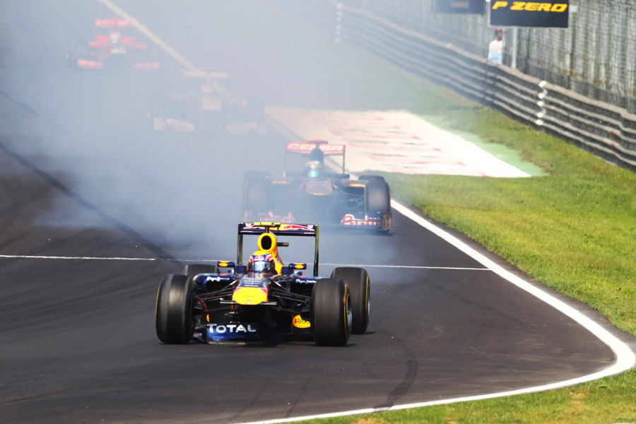 Mark Webber locks up as he heads for the barriers