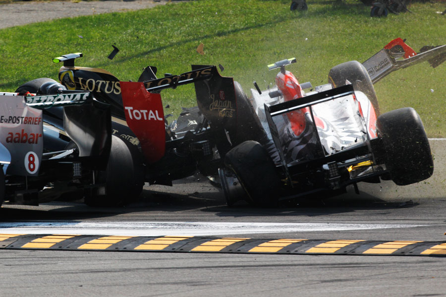 Tonio Liuzzi ploughs in to the side of Vitaly Petrov