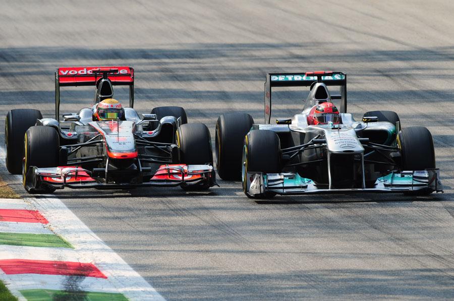 Michael Schumacher defends from Lewis Hamilton