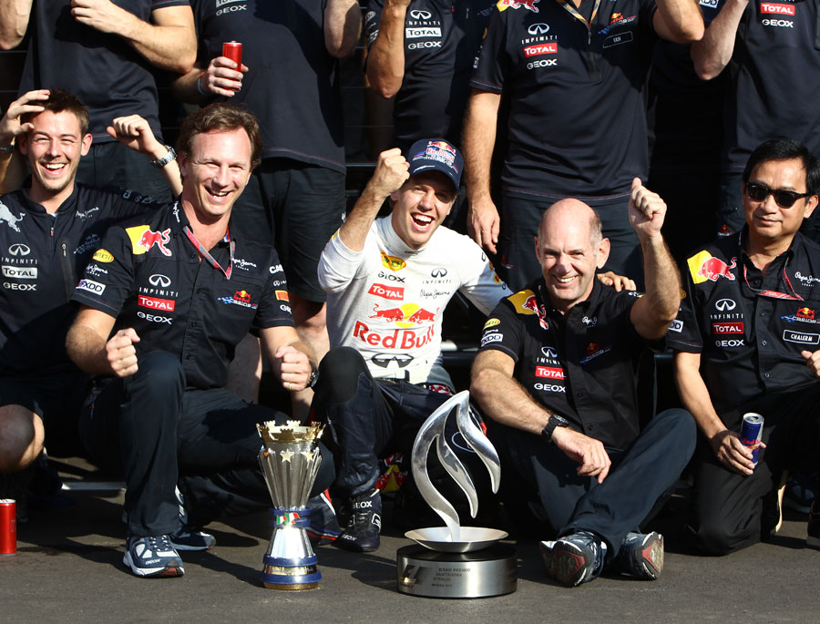 Sebastian Vettel celebrates his victory with Christian Horner and Adrian Newey