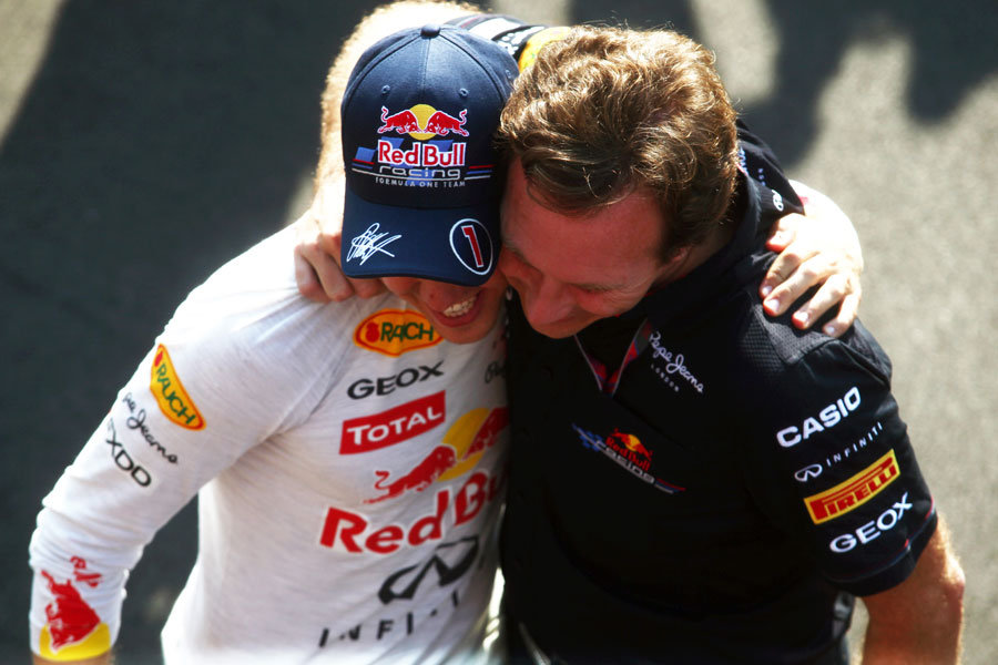 Sebastian Vettel celebrates his victory with Christian Horner