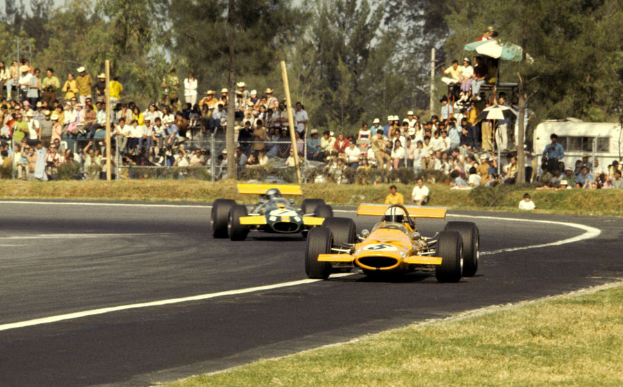 Denny Hulme comes under pressure from Jacky Ickx