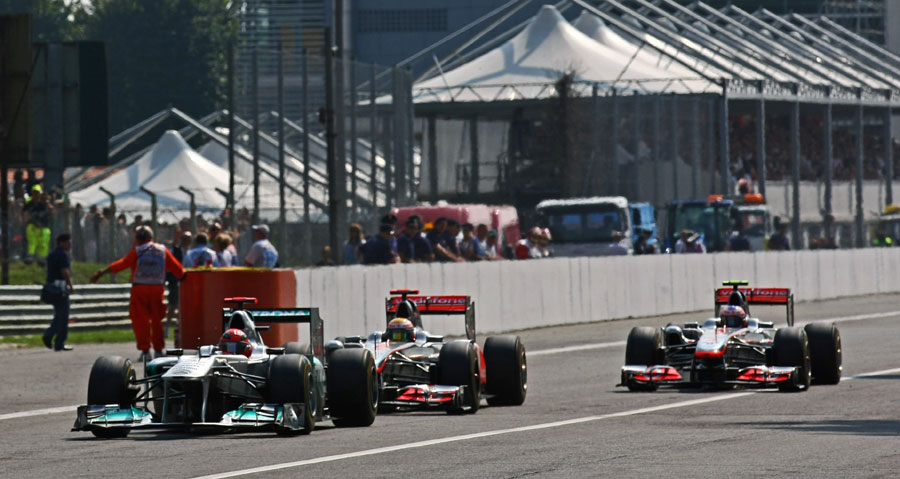 Michael Schumacher leads Lewis Hamilton and Jenson Button into the first chicane