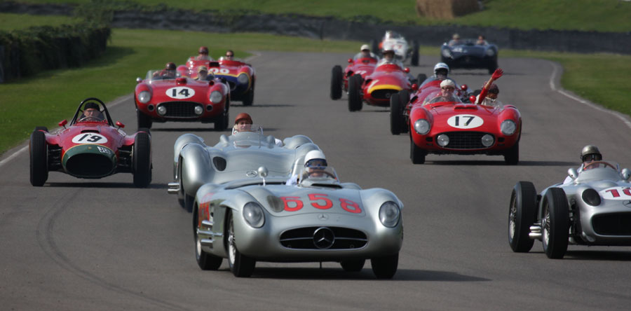 Stirling Moss (658) leads the tribute to Juan Manuel Fangio