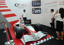 A member of the public tries an F1 simulator at the UBS headquarters in Singapore