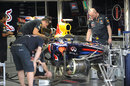 Red Bull mechanics work on Sebastian Vettel's RB7