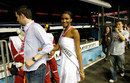 Leila Lopes of Angola, Miss Universe 2011, is led on a tour of the pit lane