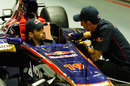 Jaime Alguersuari and Sebastien Buemi chat in the Toro Rosso garage